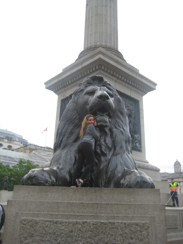 Posing with giant kitty at Trafalgar Square